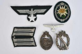 Ensemble d'insignes des Gebirgsjäger ccomprenant un edelweiss de bras en tissu (jamais monté). Une