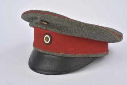 Casquette Schirmmütze de réserviste felgrau bandeau rouge, cocarde à la croix de fer. Etat II