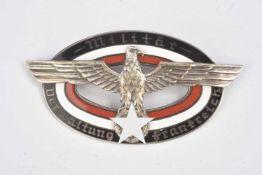 Insigne Verwarltung FrankreichEn métal, centre en émail noir, rouge et blanc. Inscription Militär
