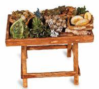 BANCONE DEL MERCATO | MARKET COUNTER Bancone del mercato, con quattro verdure in terracotta