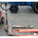 * A Crown Hand Operated Pallet truck