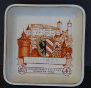 """Werbeascher """"Nürnberg"""" Heinrich-Porzellan, 10x10 cm, etwas beriebe"""