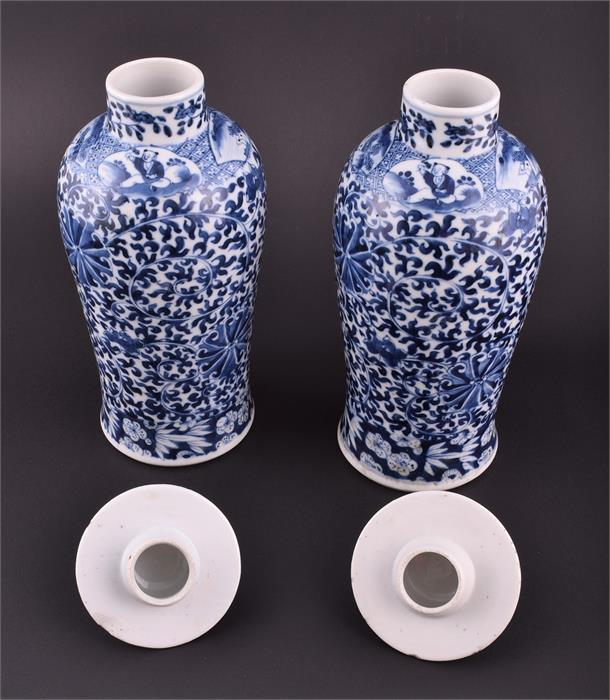 Lot 442 - A pair of late 19th century Chinese porcelain blue and white vases and covers decorated with