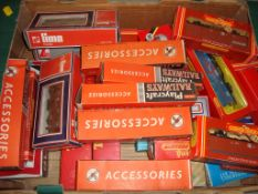 A tray of with a large quantity of boxed wagons by Hornby, Lima and others as lotted - Fair to Good,