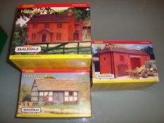 A group of Hornby Skaledale buildings as lotted Holly Farm House, Barn and Stables - appear unused -