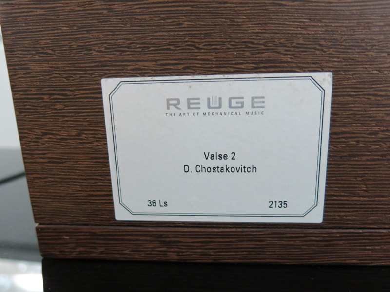Lot 5 - A Reuge Wooden Letter Rack with Wind up Mechanical Music Player. 'Plays the Vertu Signature Tune'