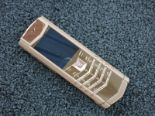 Lot 13 - Vertu Pure Chocolate Stainless Steel Phone with 18kt Red Gold Backplate. Furnished with Brown
