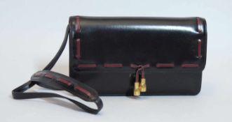 HERMES.Sac pouvant faire pochette, 1984.(haut. 14.5 cm, larg. 24 cm, prof. 4.5 cm). En cuir box