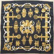 """HERMES.Carré.(90 x 90 cm). En soie, dans les tons jaunes, blancs et noir, intitulé """"FERRONNERIE"""" par"""