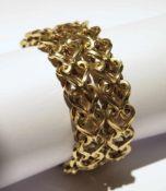 Bracelet.(long. 20.5 cm, larg. 3 cm, poids: env. 67.1 g). En or jaune 750, composé de deux