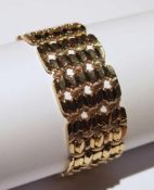 Bracelet.(long. 20 cm, larg. 3 cm, poids: env. 42.1 g). En or rose 750, à maille tissu vannerie