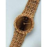 """Bracelet montre pour dame en or jaune 750 de marque """"JAEGER-LECOULTRE"""". La montre de forme ronde,"""