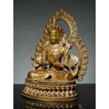 BODHISATTVA VOR DOPPELTEM NIMBUS Bronze mit Feuervergoldung. Nepal, 19. Jh. Eine besonders