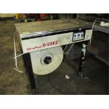 Strapack D-53X2 Semi-Automatic Box Strapper. HIT# 2188109. Building 1. Asset(s) Located at 1578