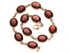 Armband: ausgesprochen schönes vintage Granatarmband in 14K Rotgold, massive und hochwertige