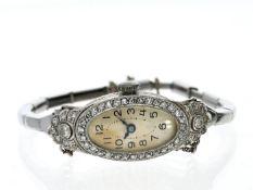 Armbanduhr: Art déco Damenuhr aus Platin, reichhaltiger Diamantbesatz, Marke Tavannes, 30er Jahre