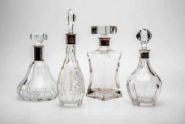Vier Kristallkaraffen mit Silbermontierung Konvolut aus vier Kristallkaraffen mit