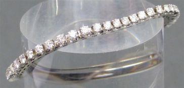 Riviere-Armband 18 kt. Weißgold, 51 Brillanten zus. ca. 5,10 ct., feines weiß, vvsi-if,