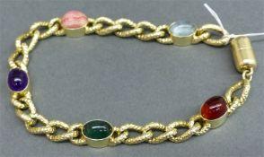 Armband 14 kt. Gelbgold, geflochten, mit geschliffenen Cabochons, Citrin, Aquamarin, Turmalin,