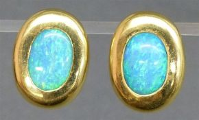 Paar Ohrclipse 18 kt. Gelbgold, 2 ovale Opale, mit Dorn, ca. 13 g schwer,