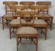 6 Biedermeierstühle, um 1820/30 Kirsche u. Rüster, verstrebte Pyramidenbeine, gepolsterter Sitz,