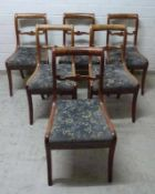 6 Biedermeier Stühle, um 1830 Cuba-Mahagoni, Säbelbeine, Volutenstrebe, Sitz gep., H/Sh 84/44 cm