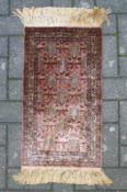 Kleiner Seidenteppich, Täbritz rotgrundig, Rautenmuster, 66x37cm