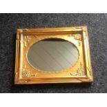 Ovale spiegel in goudkleurige lijst, 37x47cm