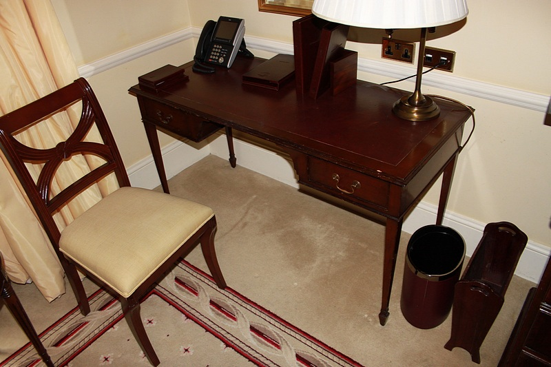 Lot 336 - A mahogany free standing inlay writing desk kneehole with two graduated drawers to each side mounted