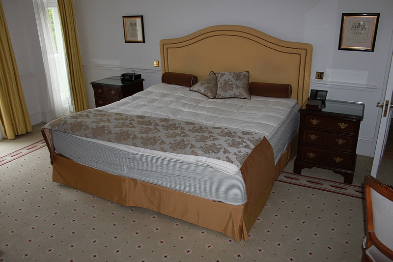 Lot 296a - Hospitality Simmons Bedding Company base, mattress and yellow double piped headboard complete with