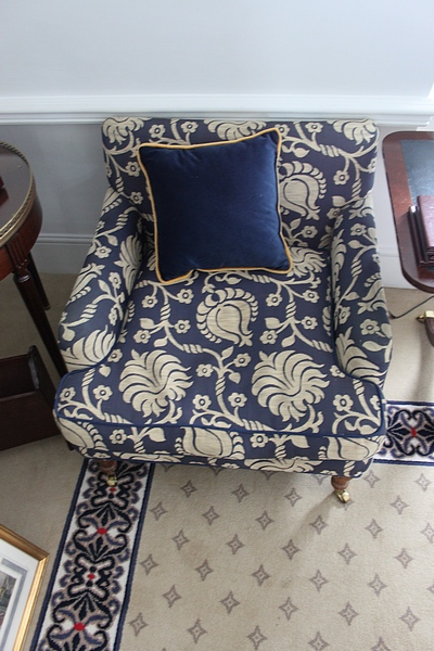 Lot 511 - A pair of traditional easy armchair upholstered in a blue broccade fabric casters to front 700 x