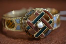 """A Victorian """"Scottish"""" yellow metal engraved articulated pebble and pearl mounted bracelet with"""