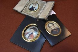 A group of three portrait miniatures, late 18th/19th century, of a gentleman in a tricorn hat, a