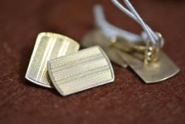 A pair of 9ct gold chainlink cufflinks, the rectangular plaques with bright-cut geometric engraving.