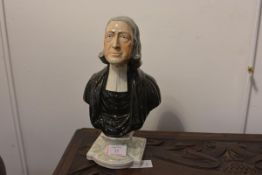 A Staffordshire bust of John Wesley, after the model by Enoch Wood, on a marbled integral socle