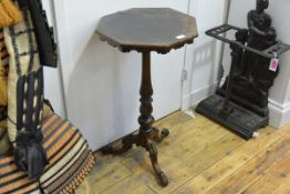 A 19th century rosewood tripod table, the octagonal top on a baluster standard over hipped leaf