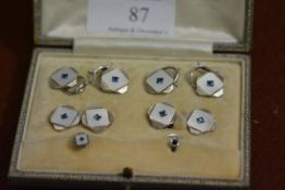 A sapphire and white and yellow gold gentleman's dress studs and cufflinks set, in the Art Deco
