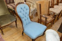 A Victorian mahogany framed nursing chair, the buttoned spoon back over a bowed seat and on short