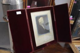 A large Edwardian red morocco folding photograph frame, with velvet interior and easel back, stamped