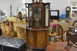 An Edwardian marquetry inlaid mahogany display cabinet, the glazed and mirror-backed