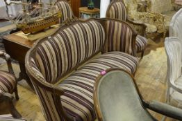A suite of Napoleon III style oak framed canape and pair of fauteuils, each piece with foliate and