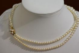 A cultured graduated two strand pearl necklace with 9ct gold clasp fastening, Length, inner strand