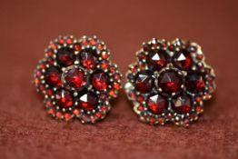 A pair of 9ct gold mounted garnet cluster earrings. Gross weight 4.58g