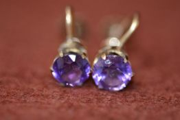 A pair of 9ct gold mounted amethyst stud earrings mounted in claw setting with screw fastenings, 2.