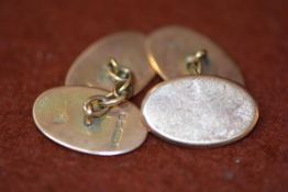 A pair of rose gold chainlink cufflinks, oval, unengraved.