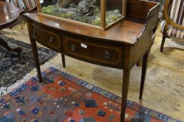 A George III mahogany bowfronted washstand, the inlaid wooden gallery enclosing a top with chevron