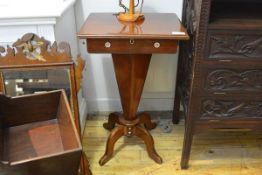 An early Victorian mahogany work table, the rectangular hinged top opening to a fitted interior,