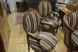 A pair of Napoleon III style oak framed fauteuils, each with oval back, foliate and scroll carved