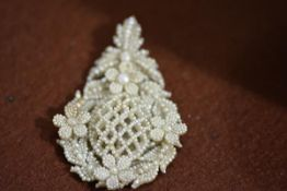 A late 18thc/early 19thc seed pearl and blister pearl articulated pendant in the rococco style, with