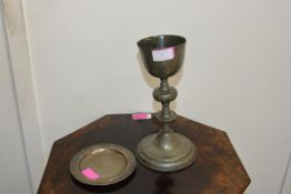 A pewter chalice, probably 17th/18th century, the shallow bowl raised on a knopped stem (repair) and
